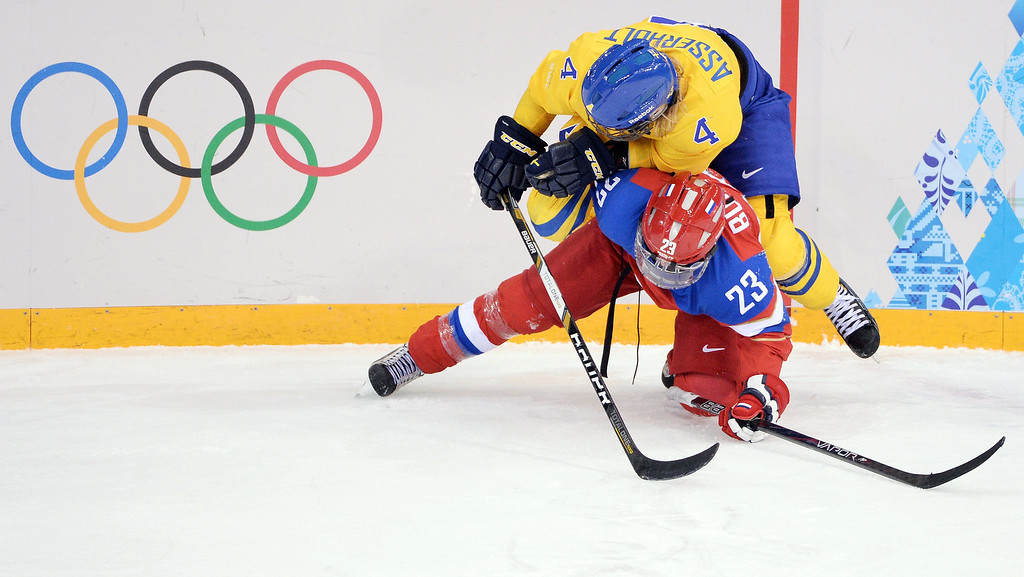 . Russia\'s Tatyana Burina (bottom) vies with Sweden\'s Jenni Asserholt during the Women\'s Ice Hockey Group B match between Sweden and Russia at the Shayba Arena during the Sochi Winter Olympics on February 13, 2014.   ANDREJ ISAKOVIC/AFP/Getty Images