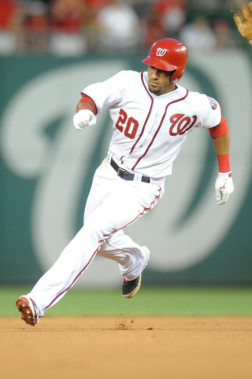 . Ian Desmond #20 of the Washington Nationals runs to third base and later ruled home run in the seventh inning, to give the Nationals the lead, during a baseball against the Colorado Rockies on July 2, 2014 at Nationals Park in Washington, DC. (Photo by Mitchell Layton/Getty Images)