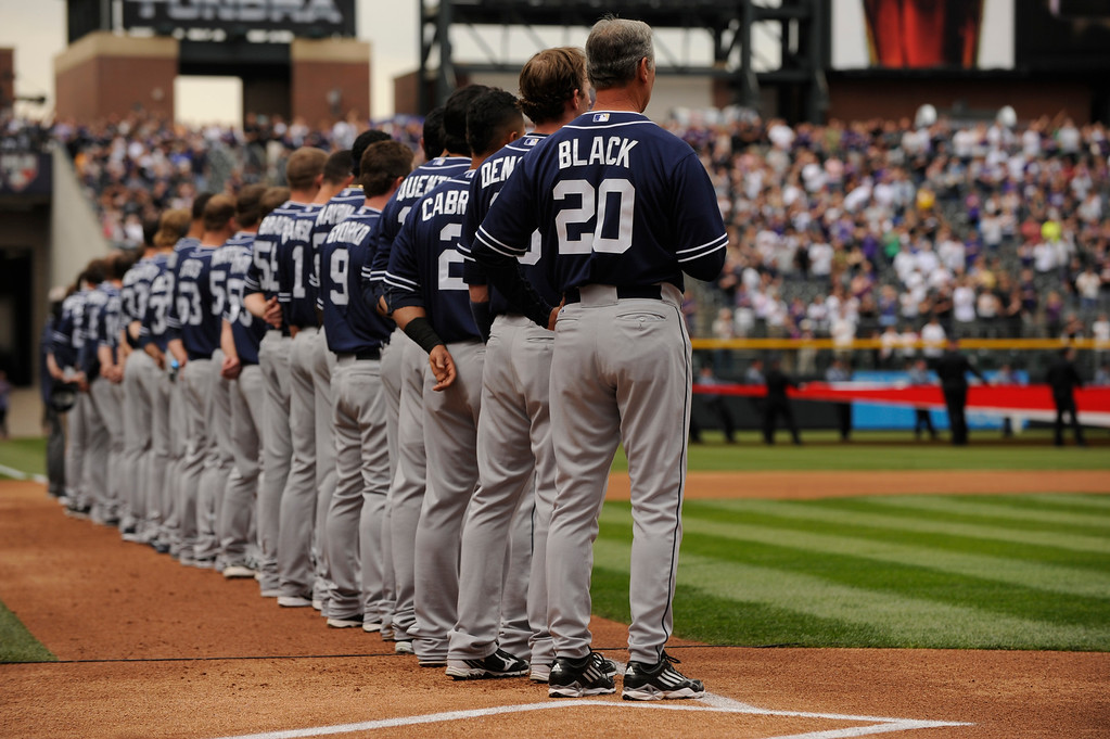 . The San Diego Padres line up for the National Anthem before the start of the game.  (Photo by Karl Gehring/The Denver Post)