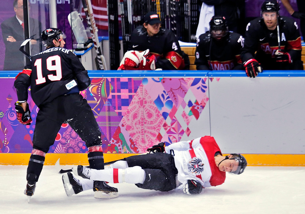 . Jay Bouwmeester (L) of Canada clashes with Austria player Thomas Raffl (R) during the match between Canada and Austria at the Bolshoy Ice dom in the Ice Hockey tournament at the Sochi 2014 Olympic Games, Sochi, Russia, 14 February 2014.  EPA/ANATOLY MALTSEV