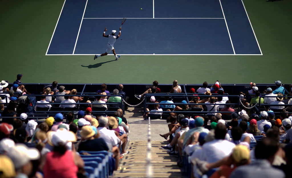 . Roberto Bautista Agut, of Spain, returns a shot to David Ferrer, of Spain, during the second round of the 2013 U.S. Open tennis tournament, Thursday, Aug. 29, 2013, in New York. (AP Photo/David Goldman)