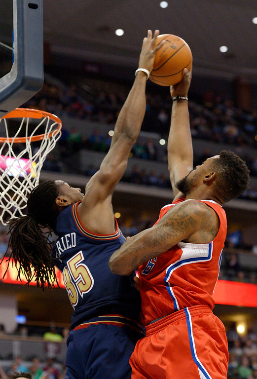 . Denver Nuggets forward Kenneth Faried (35) blocks a shot by Los Angeles Clippers center DeAndre Jordan (6) during the third quarter (Photo by John Leyba/The Denver Post)