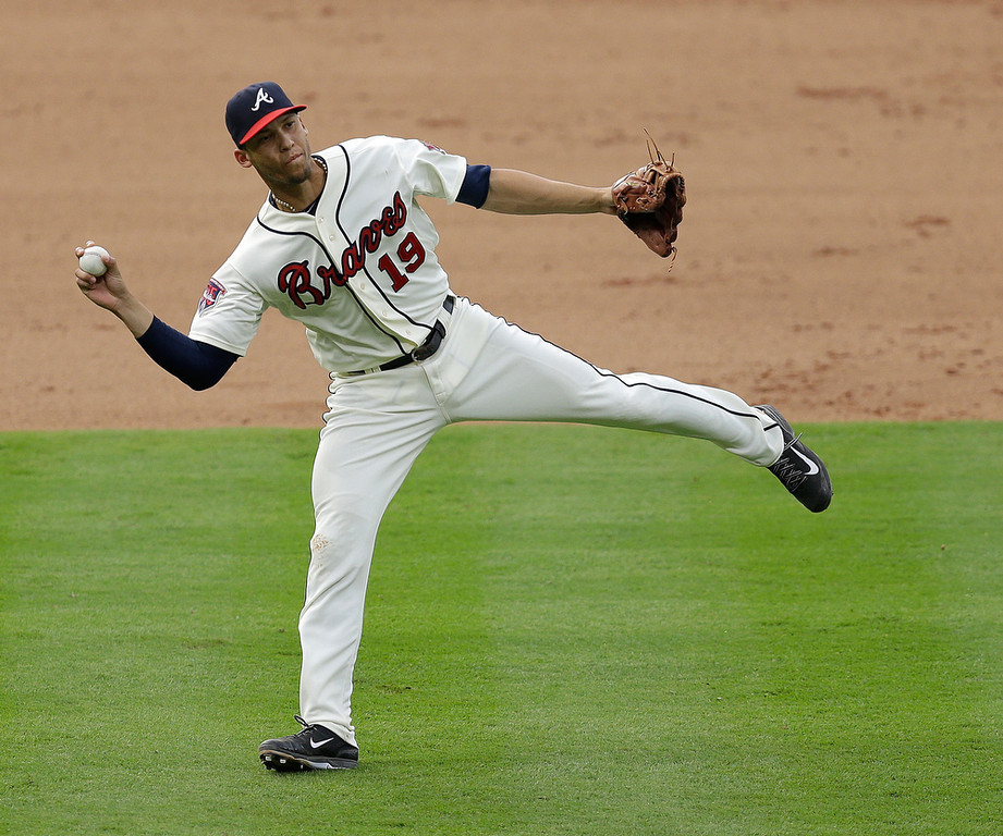 . Shortstop Andrelton Simmons #19 of the Atlanta Braves fields a ground ball but holds on the throw in the eighth inning of the game against the Colorado Rockies at Turner Field on May 24, 2014 in Atlanta, Georgia.  (Photo by Mike Zarrilli/Getty Images)