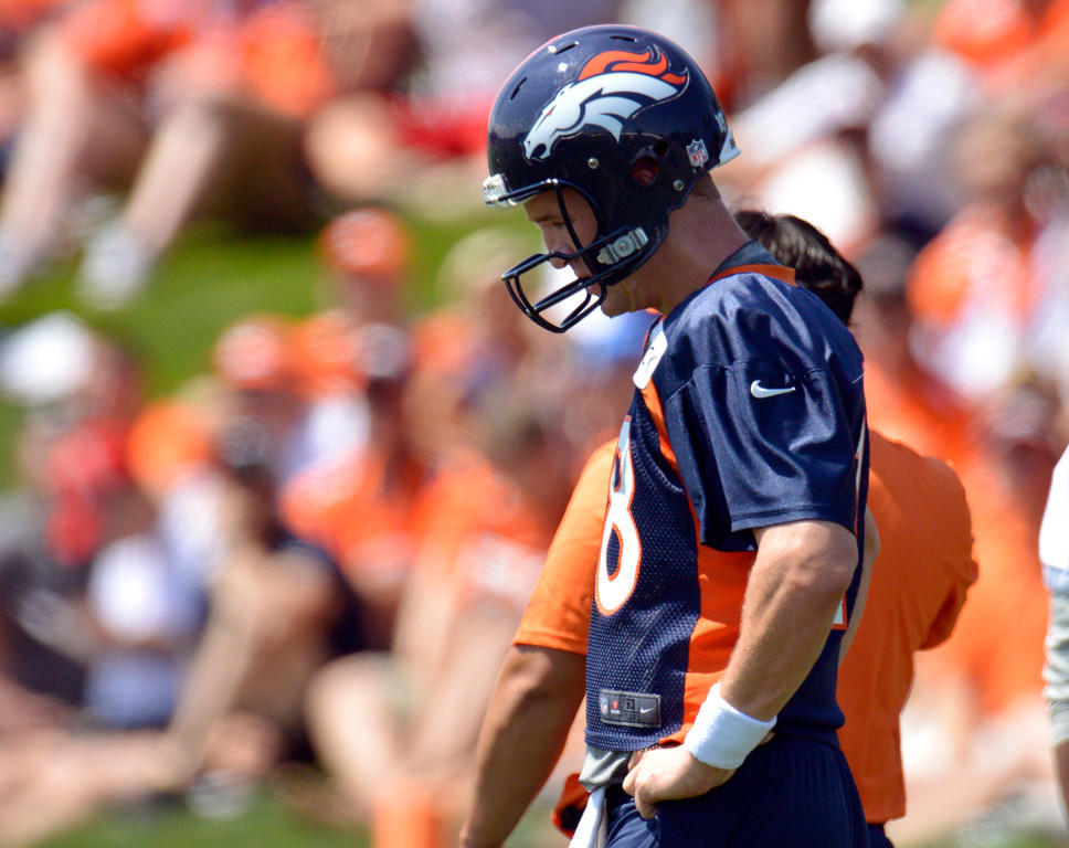 . Denver Broncos Peyton Manning (18) gathers his thoughts during training camp July 26, 2013 at Dove Valley. (Photo By John Leyba/The Denver Post)