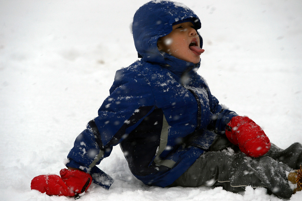 . BOULDER, CO- FEBRUARY 19:   Max Waters, 6, visiting from Florida, tries to capture snowflakes on his tongue in Washington Park on February 20, 2013.  Snow hit the Denver metro area around 2:30 with forecasters calling for  2-4 inches in Denver more to the South and East.  (Photo By Helen H. Richardson/ The Denver Post)