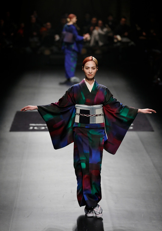 . Models display creations from Japanese designer Jotaro Saito\'s 2014-2015 Autumn/Winter collection at Tokyo Fashion Week  in Tokyo, Wednesday, March 19, 2014. (AP Photo/Shizuo Kambayashi)