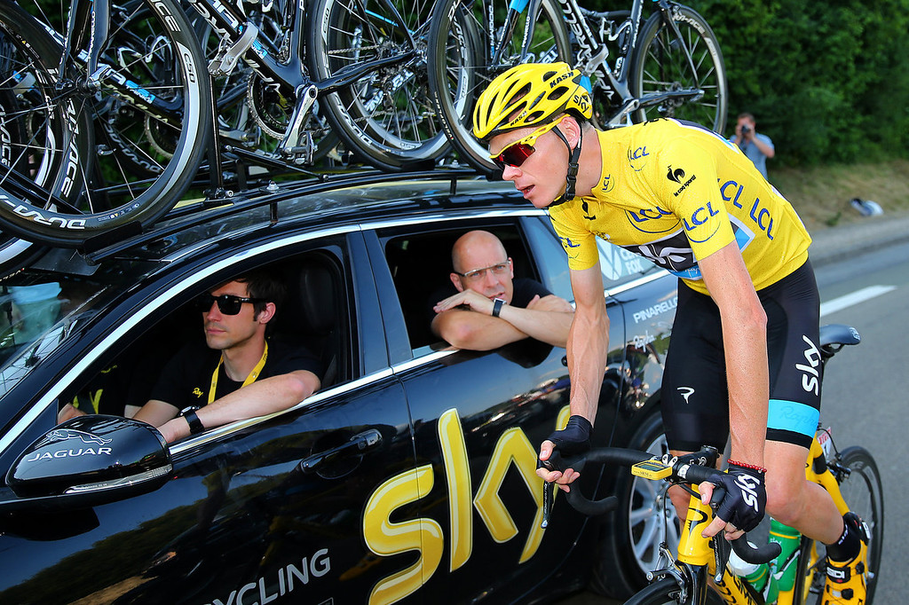 . SKY Procycling General Manager Sir Dave Brailsford (C) and Sports Director Nicolas Portal (L) speak with the winner of the 2013 Tour de France, Chris Froome of Great Britain and SKY during the twenty first and final stage of the 2013 Tour de France, a processional 133.5KM road stage ending in an evening race around the Champs-Elysees, on July 21, 2013 in Paris, France.  (Photo by Bryn Lennon/Getty Images)