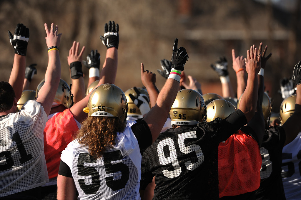 . BOULDER, CO- MARCH 7 :  Players raise their hands before practice. The Colorado Buffaloes football team hit the practice field for the first time this season with new head coach Mike MacIntyre in Boulder, CO on March 7, 2013. (Photo By Helen H. Richardson/ The Denver Post)
