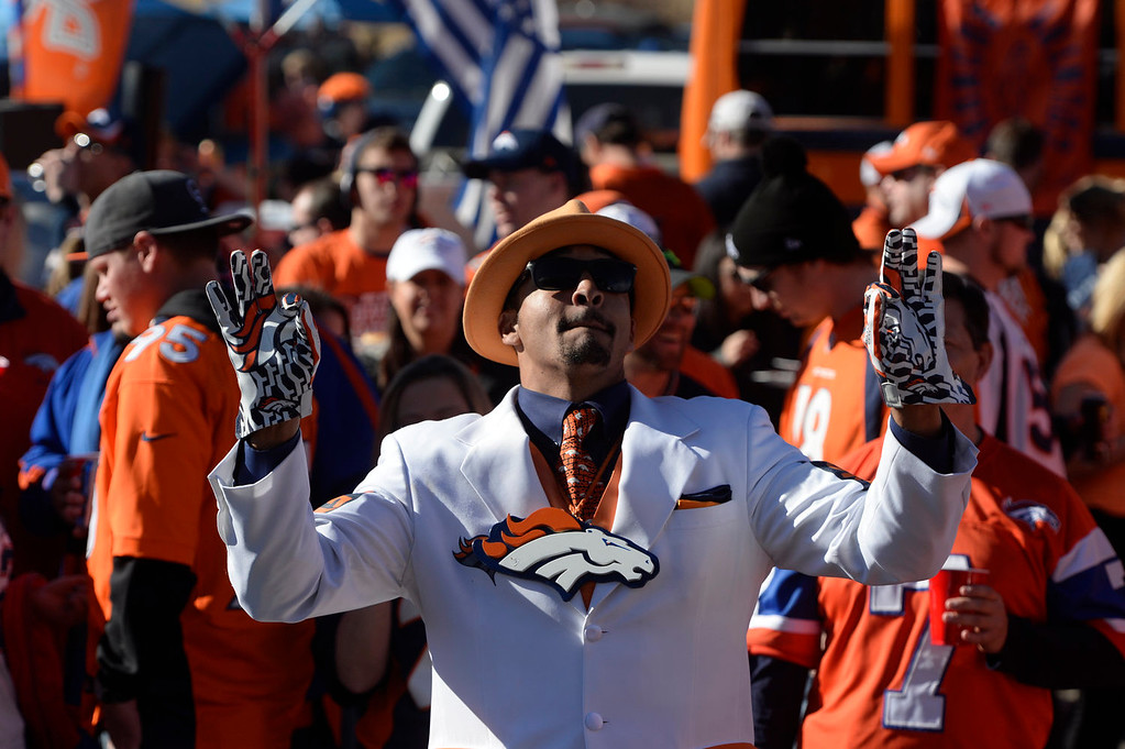 . Justin Grimmett of Denver listens to the Stampede Band before the game. The Denver Broncos take on the New England Patriots in the AFC Championship game at Sports Authority Field at Mile High in Denver on January 19, 2014. (Photo by Craig F. Walker/The Denver Post)
