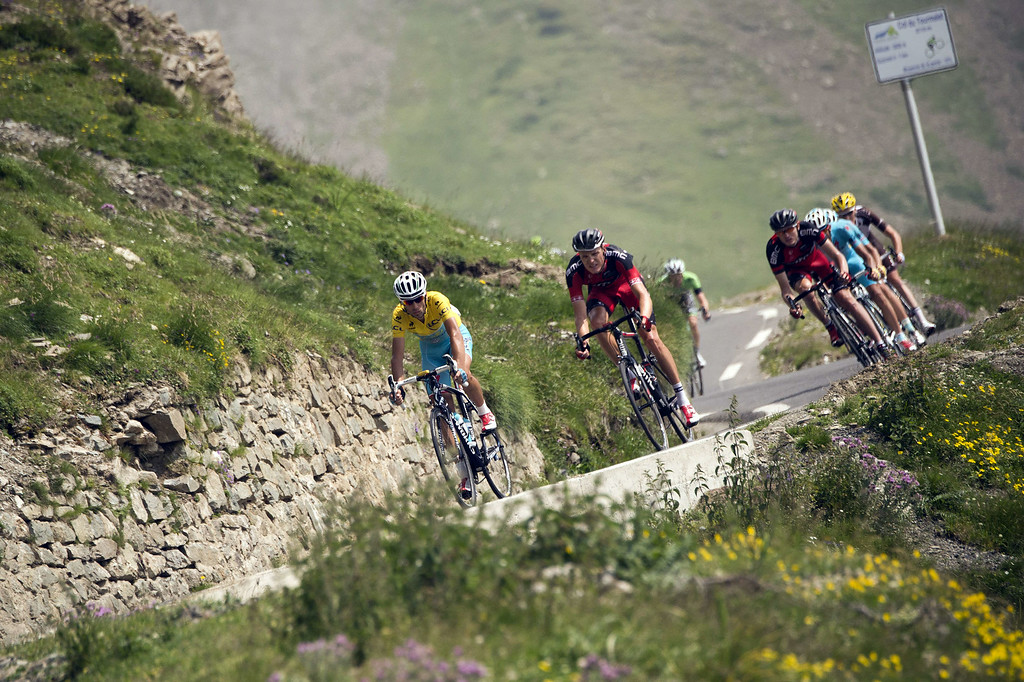 . Italy\'s Vincenzo Nibali wearing the overall leader\'s yellow jersey rides in a breakaway during the 145.5 km eighteenth stage of the 101st edition of the Tour de France cycling race on July 24, 2014 between Pau and Hautacam, southwestern France.  AFP PHOTO / LIONEL  BONAVENTURE/AFP/Getty Images