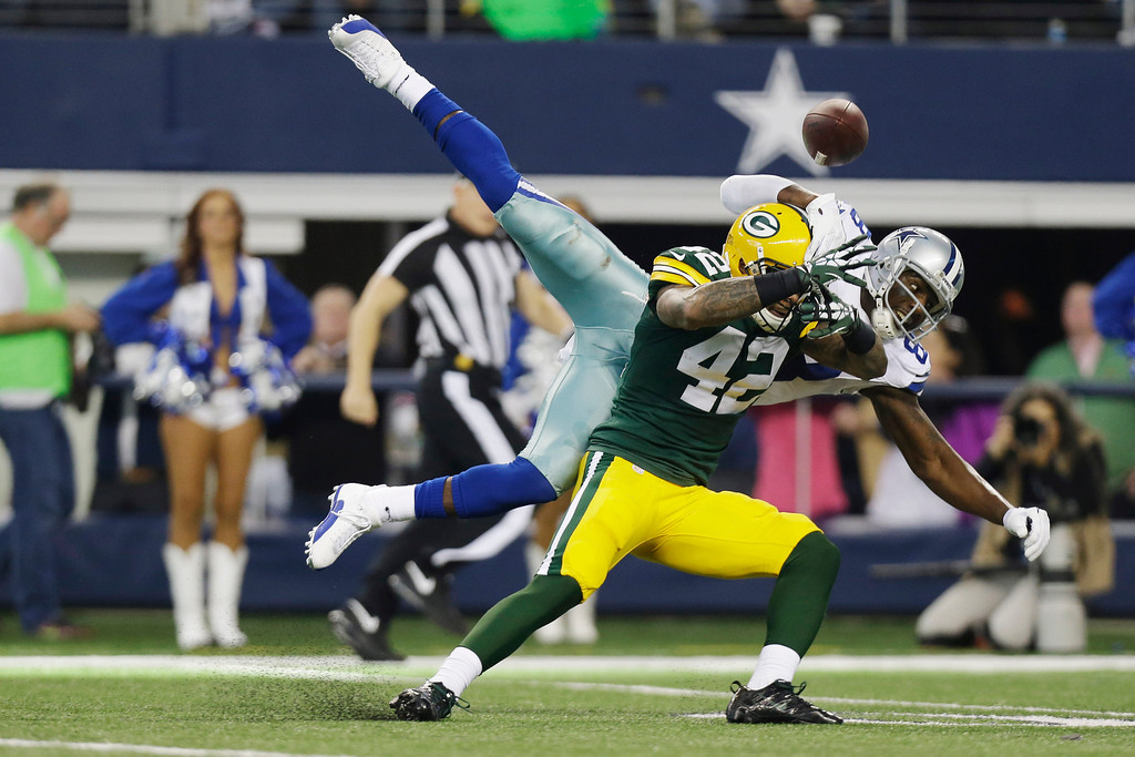 . Dallas Cowboys wide receiver Dez Bryant (88) misses a pass as Green Bay Packers strong safety Morgan Burnett (42) defends during the first half of an NFL football game, Sunday, Dec. 15, 2013, in Arlington, Texas. (AP Photo/Tim Sharp)