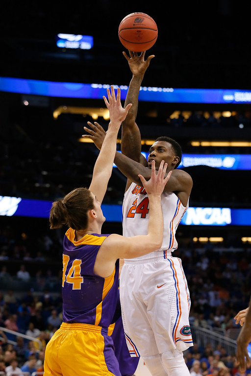 . ORLANDO, FL - MARCH 20:  Casey Prather #24 of the Florida Gators shoots over John Puk #44 of the Albany Great Danes in the first half during the second round of the 2014 NCAA Men\'s Basketball Tournament at Amway Center on March 20, 2014 in Orlando, Florida.  (Photo by Kevin C. Cox/Getty Images)