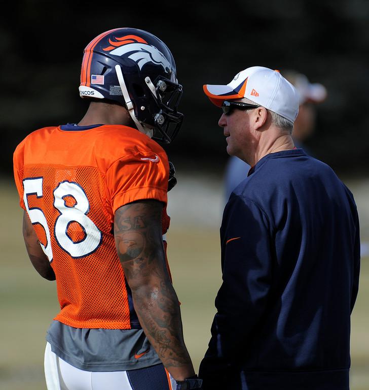 . Denver Broncos head coach John Fox talks with Von Miller (58) during practice December 18, 2013 at Dove Valley (Photo by John Leyba/The Denver Post)