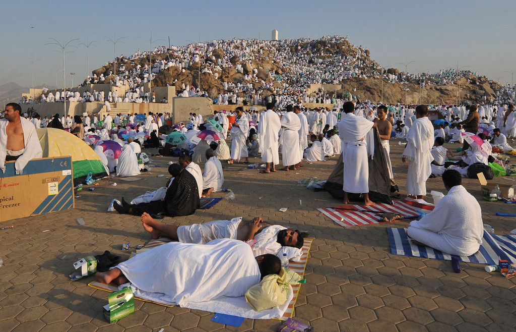 . Muslim pilgrims rest as others climb Mount Arafat (background), near the holy city of Mecca, ahead of the hajj main ritual, on October 14, 2013.  AFP PHOTO/FAYEZ  NURELDINE/AFP/Getty Images