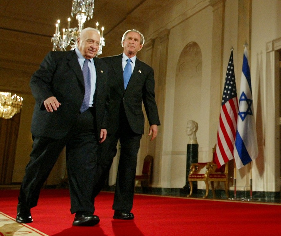 . In this Wednesday, April 14, 2004 file photo, President Bush, right, and Israeli Prime Minister Ariel Sharon, left, walk together at the end of a joint press conference in the Cross Hall of the White House in Washington.   (AP Photo/Pablo Martinez Monsivais)