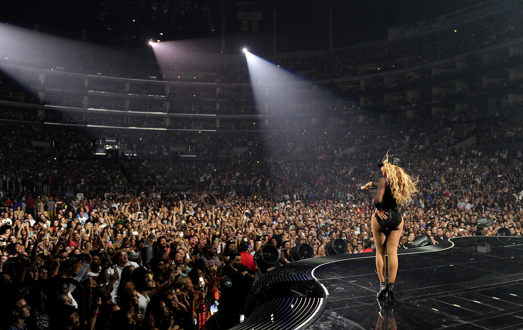 """. Singer Beyonce performs on her \""""Mrs. Carter Show World Tour 2013\"""" at Staples Center on Monday, July 1, 2013, in Los Angeles. Beyonce is wearing a custom hand beaded one-piece by Givenchey.  (Photo by Frank Micelotta/Invision for Parkwood Entertainment/AP Images)"""