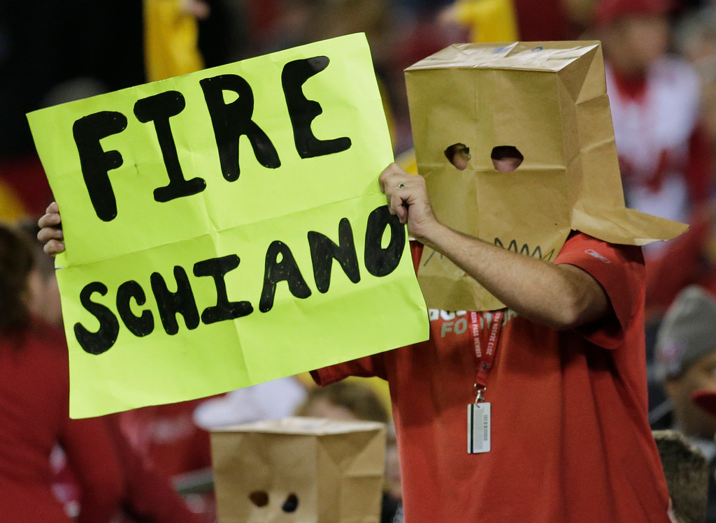 . A Tampa Bay Buccaneers fan, wearing a paper bag, holds up a sign during the fourth quarter of an NFL football game against the Carolina Panthers, Thursday, Oct. 24, 2013, in Tampa, Fla. (AP Photo/Chris O\'Meara)