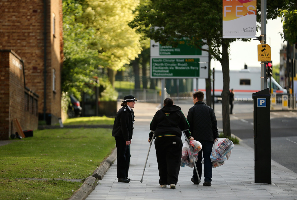 . Police talk to local residents near to the scene in Woolwich, following a major incident in which a man was killed, on May 22, 2013 in London, England.   (Photo by Dan Kitwood/Getty Images)