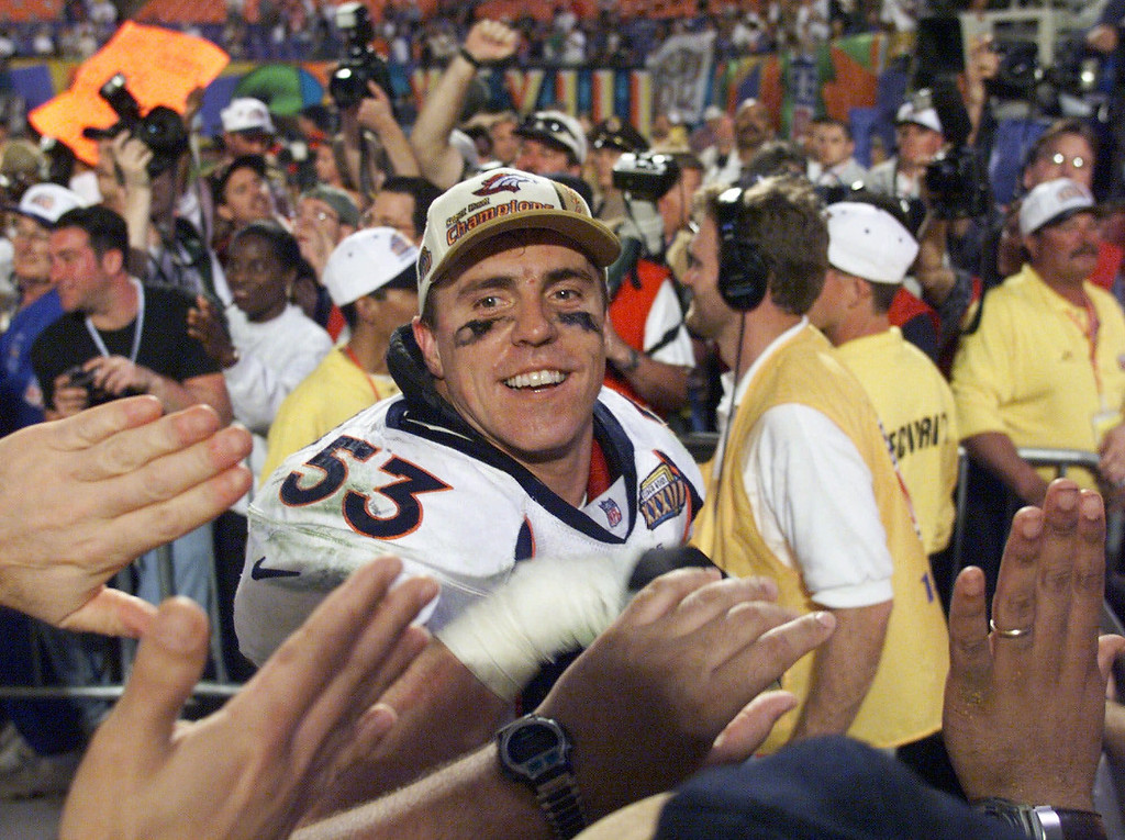 . Denver Broncos linebacker Bill Romanowski greets fans as he leaves Pro Player Stadium in Miami Sunday Jan. 31, 1999, after the Broncos defeated the Atlanta Falcons 34-19 in Super Bowl XXXIII. (AP Photo/Doug Mills)