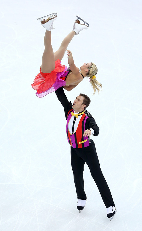 Description of . Kirsten Moore-Towers and Dylan Moscovitch of Canada compete during the Figure Skating Pairs Short Program on day four of the Sochi 2014 Winter Olympics at Iceberg Skating Palace on February 11, 2014 in Sochi, Russia.  (Photo by Matthew Stockman/Getty Images)