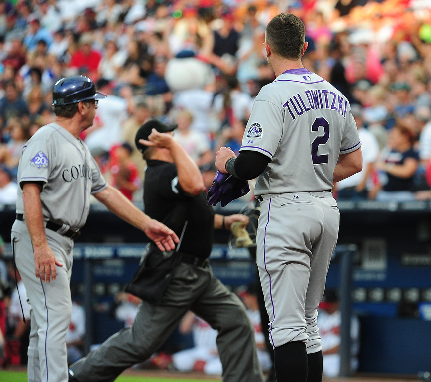 . Troy Tulowitzki #2 of the Colorado Rockies is ejected from the game against the Atlanta Braves by Umpire Marvin Hudson at Turner Field on August 1, 2013 in Atlanta, Georgia. (Photo by Scott Cunningham/Getty Images)
