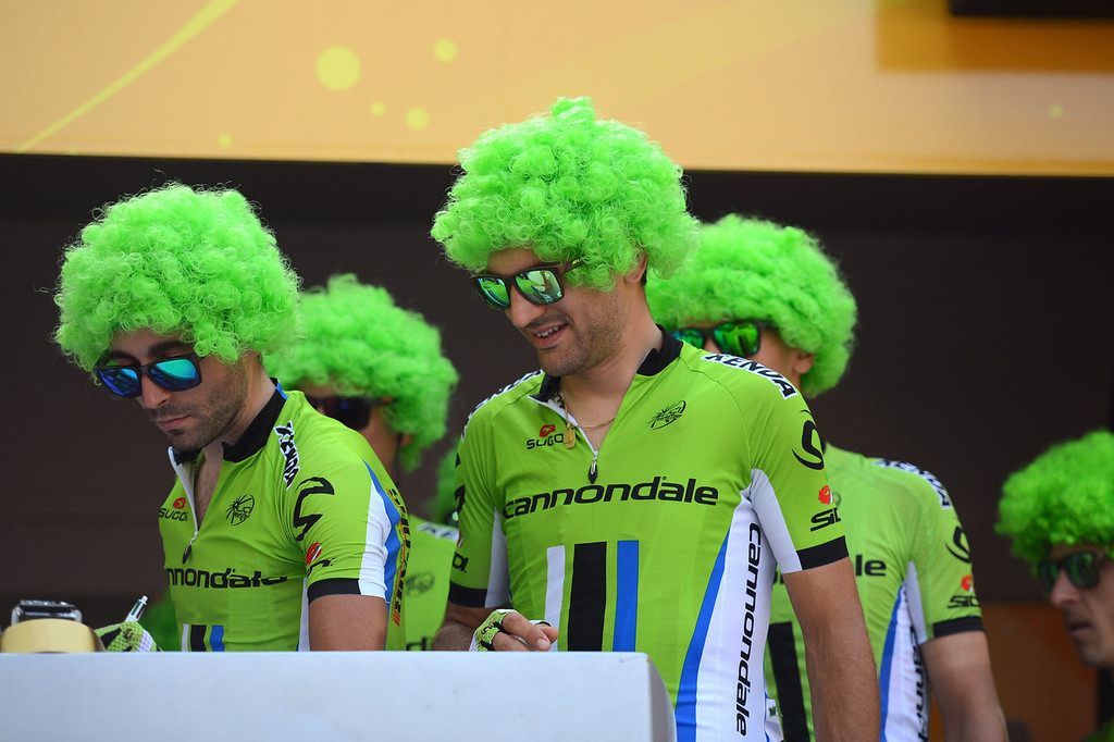 . Riders of the Italian Cannondale cycling team wear a green wig to celebrate the green jersey of best sprinter of their teammate Slovakia\'s Peter Sagan during the signature ceremony in Versailles, outside Paris, at the departure village, before the start of the 133.5 km twenty-first and last stage of the 100th edition of the Tour de France cycling race on July 21, 2013 between Versailles and Paris.  JOEL SAGET/AFP/Getty Images