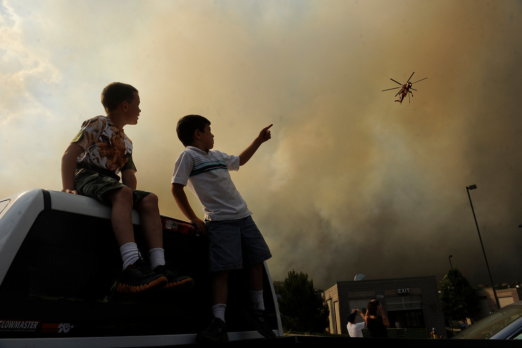 . Caden Manes, 8, right and Ryan Kent, 6, left, watch as the Waldo Canyon fire explodes today June 26th, 2012  The Waldo Canyon fire continues to burn northwest of Manitou Springs, Colorado today June 26th, 2012.  Helen H. Richardson, The Denver Post