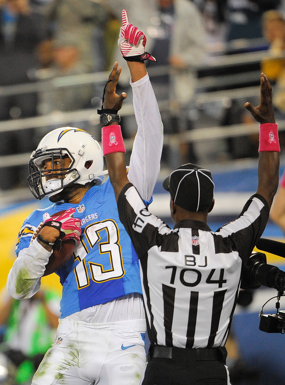 . San Diego Chargers wide receiver Keenan Allen, left, celebrates his touchdown against the Indianapolis Colts during the first half of an NFL football game Monday, Oct. 14, 2013, in San Diego. (AP Photo/Denis Poroy)