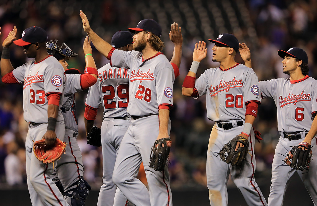. The Washington Nationals celebrate their 5-1 victory over the Colorado Rockies at Coors Field on June 12, 2013 in Denver, Colorado.  (Photo by Doug Pensinger/Getty Images)