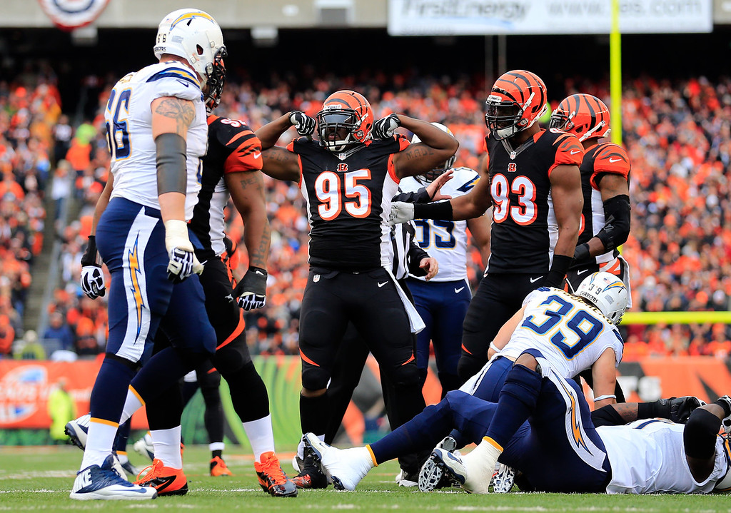 . Defensive end Wallace Gilberry #95 of the Cincinnati Bengals reacts against the San Diego Chargers during a Wild Card Playoff game at Paul Brown Stadium on January 5, 2014 in Cincinnati, Ohio.  (Photo by Rob Carr/Getty Images)