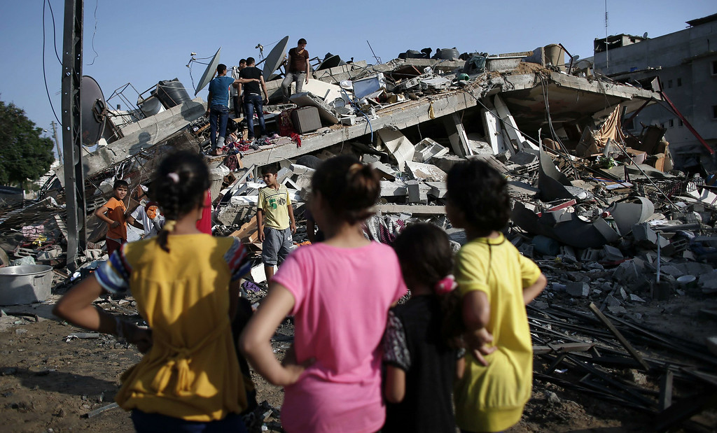 . Palestinians look at a house that was destroyed by an Israeli air strike in Gaza City on August 23, 2014.   A powerful Israeli air strike leveled the house, of a family that included members of Hamas, late Friday, after a drone fired two rockets at the two-story property before an F16 warplane dropped a bomb, according to witnesses.  Israel kept up the pressure on Hamas in Gaza, carrying out multiple air strikes that killed six Palestinians, five of them from the same family, as Egypt readied to call new truce talks. THOMAS COEX/AFP/Getty Images