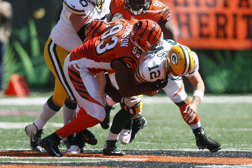 . Michael Johnson #93 of the Cincinnati Bengals sacks Aaron Rodgers #12 of the Green Bay Packers during their game at Paul Brown Stadium on September 22, 2013 in Cincinnati, Ohio.  The Bengals defeated the Packers 34-30. (Photo by John Grieshop/Getty Images)