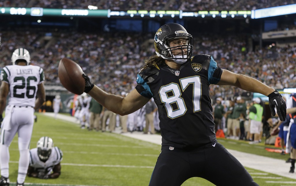 . Jacksonville Jaguars tight end Allen Reisner celebrates after scoring on a touchdown pass from quarterback Blaine Gabbert during the first half of an NFL preseason football game against the New York Jets, Saturday, Aug. 17, 2013, in East Rutherford, N.J. (AP Photo/Seth Wenig)