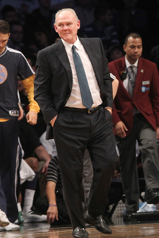 . Denver Nuggets head coach George Karl watches the action during the second half of an NBA basketball game against the Brooklyn Nets, Wednesday, Feb. 13, 2013, at Barclays Center in New York. The Nuggets won 119-108. (AP Photo/Mary Altaffer)