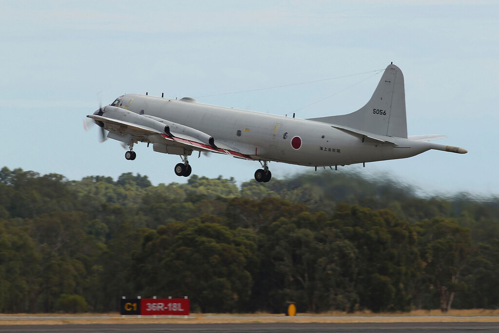 . A Japan Maritime Self-Defense Force P-3C Orion takes off from the Royal Australian Air Force Pearce Base to commence a search for possible debris from the missing Malaysia Airlines flight MH370, in Perth, Australia, Monday, March 24, 2014. (AP Photo/Paul Kane, Pool)