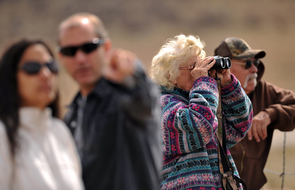 . FORT COLLINS, CO. - MARCH 16: People watch the Galena wildfire in Larimer County. The wildfire pushed west overnight through Lory State Park, driven by wind gusts reaching 45 mph. Fort Collins, Colorado. March 16, 2013. (Photo By Hyoung Chang/The Denver Post)