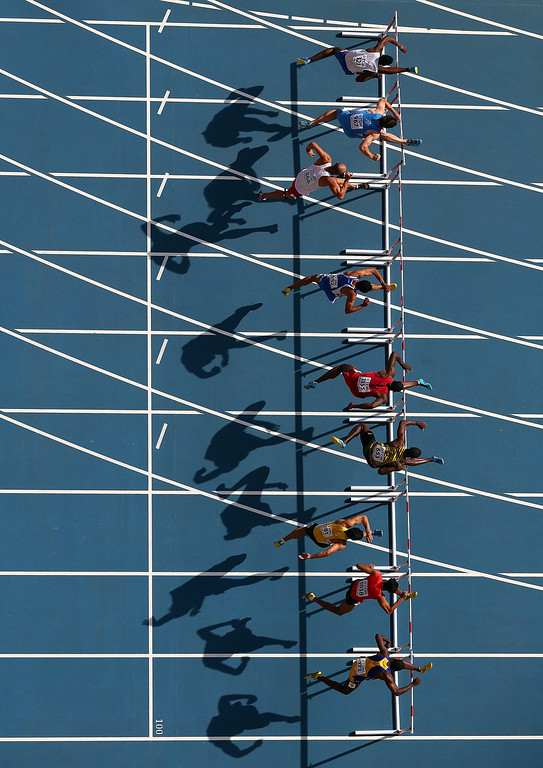 . From top, Ignacio Morales of Cuba, Sergey Shubenkov of Russia, Artur Noga of Poland, Konstadinos Douvalidis of Greece, David Oliver of the United States, Andrew Riley of Jamaica, Rayzam Shah Wan Sofian of Malaysia, Jumrut Rittidech of Thailand and Greggmar Swift of Barbados compete in the Men\'s 110 metres hurdles heats during Day Two of the 14th IAAF World Athletics Championships Moscow 2013 at Luzhniki Stadium on August 11, 2013 in Moscow, Russia.  (Photo by Julian Finney/Getty Images)