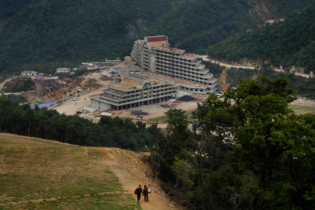 """. An unfinished hotel complex stands at the bottom of a mountain slope at the ski resort construction project at North Korea\'s Masik Pass. This is the Masik Pass ski resort, North Korea\'s latest megaproject, the product of 10 months of furious labor intended to show the world that this country, so often derided for its poverty and isolation, is as civilized and culturally advanced as any other. North Korean authorities have been encouraging a broader interest in sports in the country, calling it \""""the hot wind of sports blowing through Korea.\"""" (AP Photo/David Guttenfelder)"""