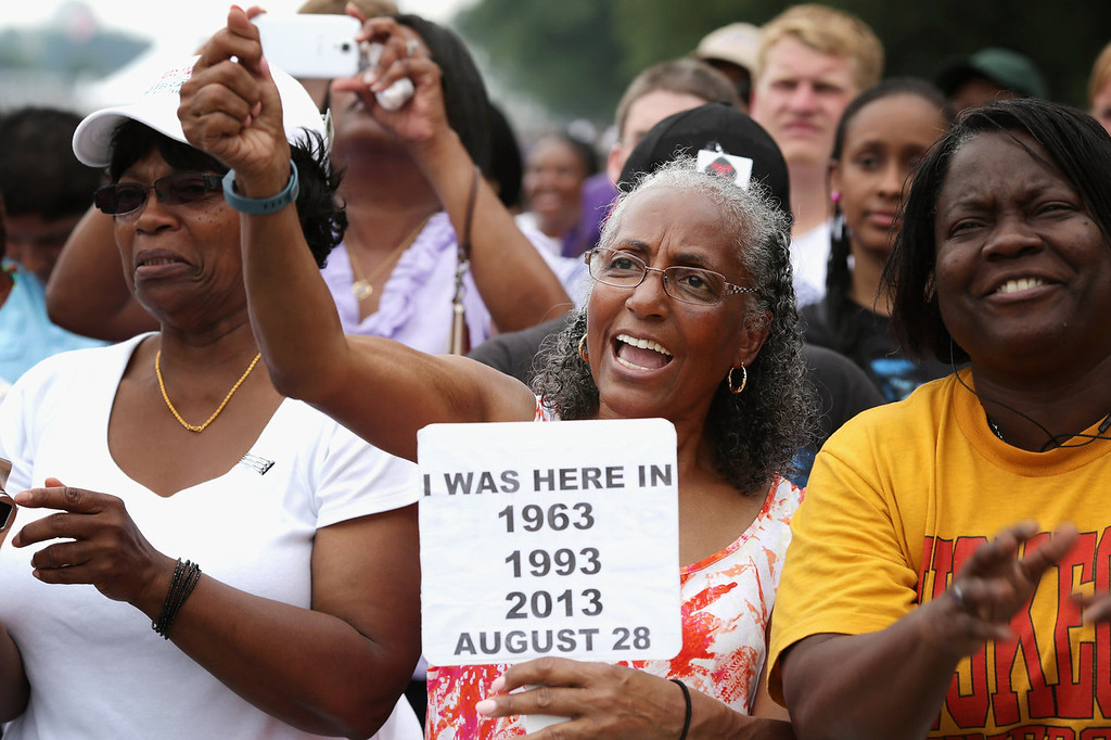 ". Betty Waller Gray (C) of Richmond, Virginia, cheers during the \'Let Freedom Ring Commemoration and Call to Action\' honoring the 50th anniversary of the historic March on Washington for Jobs and Freedom on the National Mall August 28, 2013 in Washington, DC. The 1963 landmark civil rights event was where Dr. Martin Luther King Jr. delivered his famous speech, saying, \'I still have a dream, a dream deeply rooted in the American dream...one day this nation will rise up and live up to its creed, ""We hold these truths to be self evident: that all men are created equal.\"" I have a dream . . .\'  (Photo by Chip Somodevilla/Getty Images)"