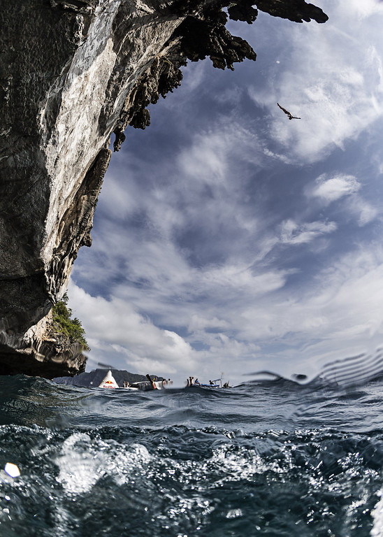 . In this handout image provided by Red Bull, Alain Kohl of Luxembourg dives from a 25 meter rock at Viking Caves in the Andaman Sea during competition on the fifth day of the final stop of the 2013 Red Bull Cliff Diving World Series on October 24, 2013 at Phi Phi Island, Thailand. (Photo by Samo Vidic/Red Bull via Getty Images)