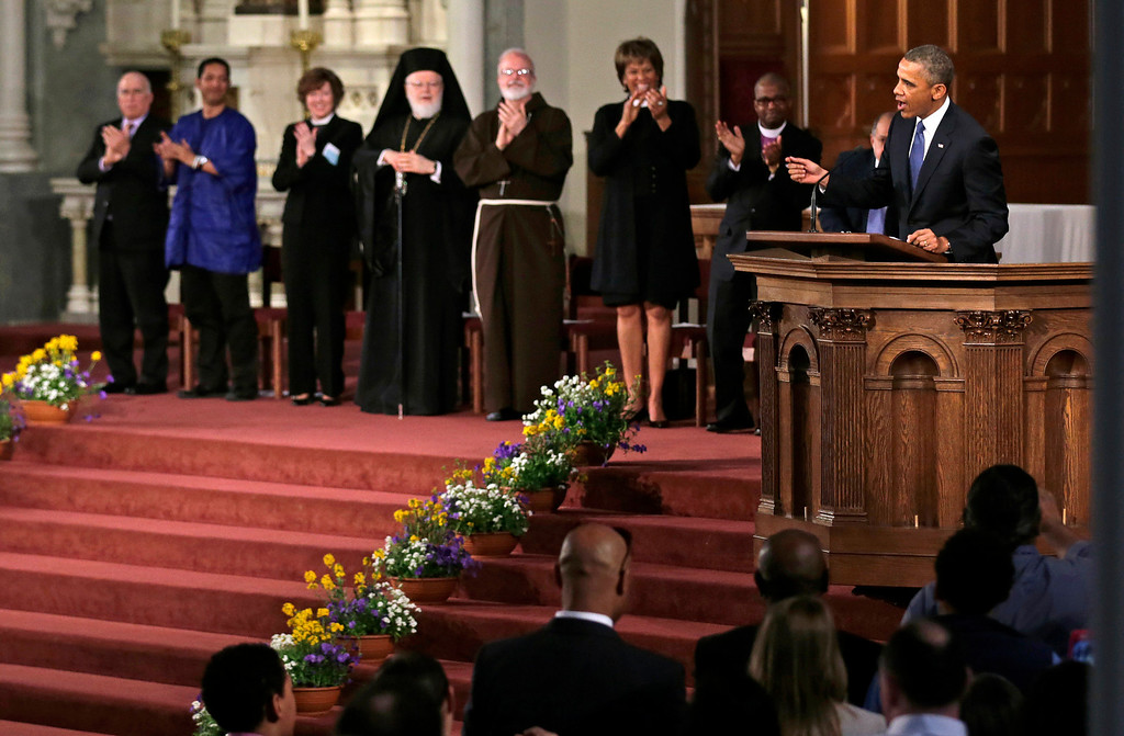 . President Barack Obama speaks during an interfaith healing service at the Cathedral of the Holy Cross in Boston, Thursday, April 18, 2013, for victims of Monday\'s Boston Marathon explosions. (AP Photo/Charles Krupa)