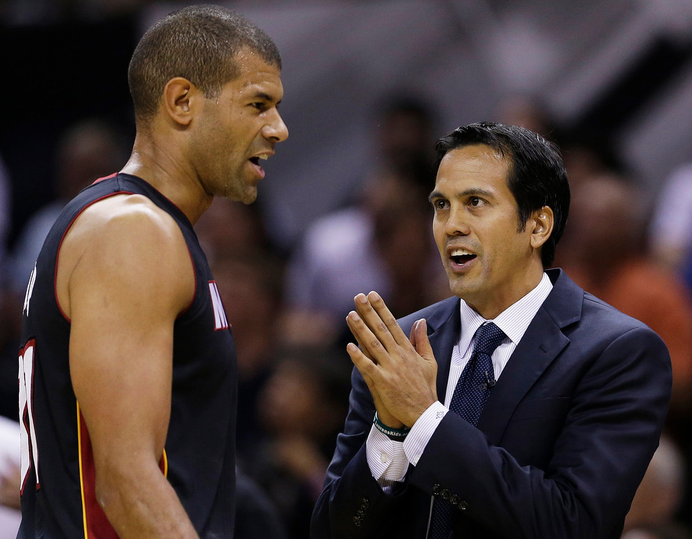 . Miami Heat forward Shane Battier, left and head coach Erik Spoelstra talk on the sideline during the first half in Game 5 of the NBA basketball finals against the San Antonio Spurs on Sunday, June 15, 2014, in San Antonio. (AP Photo/David J. Phillip)