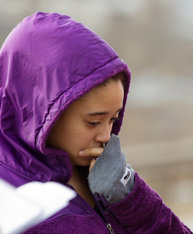 . Mariah Bryant cries as she visits the crash site that killed her half-brother, Daylan Ray, early in the morning on Park Avenue in Warren, Ohio, Sunday, March 10, 2013. (AP Photo/Scott R. Galvin)
