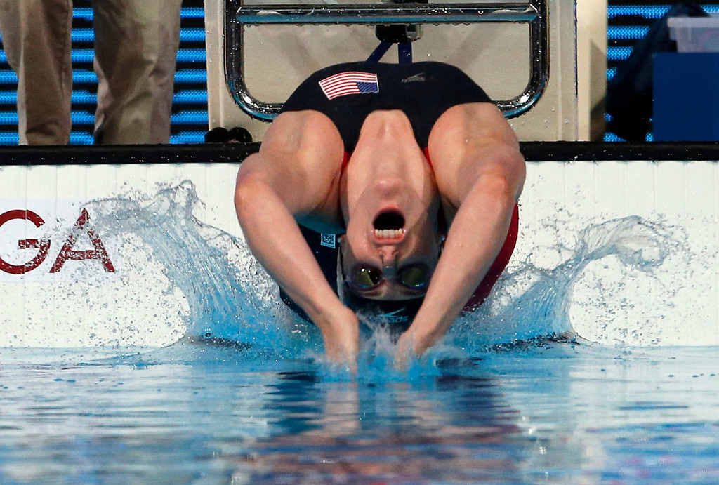 . Missy Franklin of the United States starts on her way to winning the gold medal in the Women\'s 100m backstroke final at the FINA Swimming World Championships in Barcelona, Spain, Tuesday, July 30, 2013. (AP Photo/Michael Sohn)