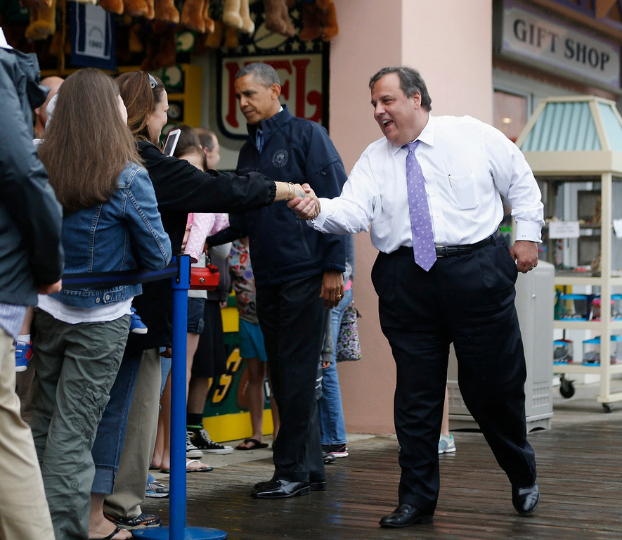 . U.S. President Barack Obama and New Jersey Governor Chris Christie meet holidaymakers on the boardwalk at Point Pleasant in New Jersey, May 28, 2013. REUTERS/Jason Reed