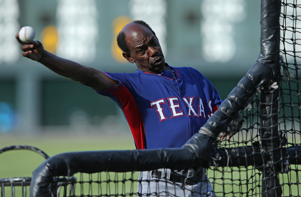 . Manager Ron Washington #38 of the Texas Rangers pitches batting practice prior to facing the Colorado Rockies during Interleague play at Coors Field on May 5, 2014 in Denver, Colorado.  (Photo by Doug Pensinger/Getty Images)