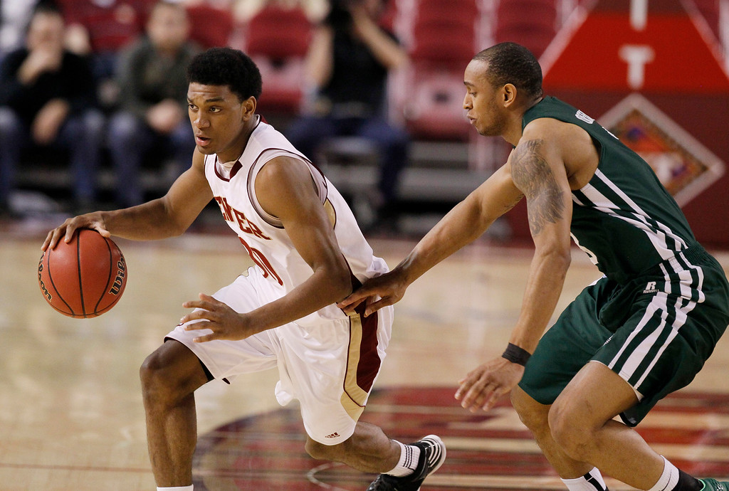 . Denver guard Cam Griffin, left, works the ball inside as Ohio guard Nick Kellogg covers in the second half of Denver\'s 61-57 victory in a first-round NIT college basketball game in Denver on Tuesday, March 19, 2013. (AP Photo/David Zalubowski)