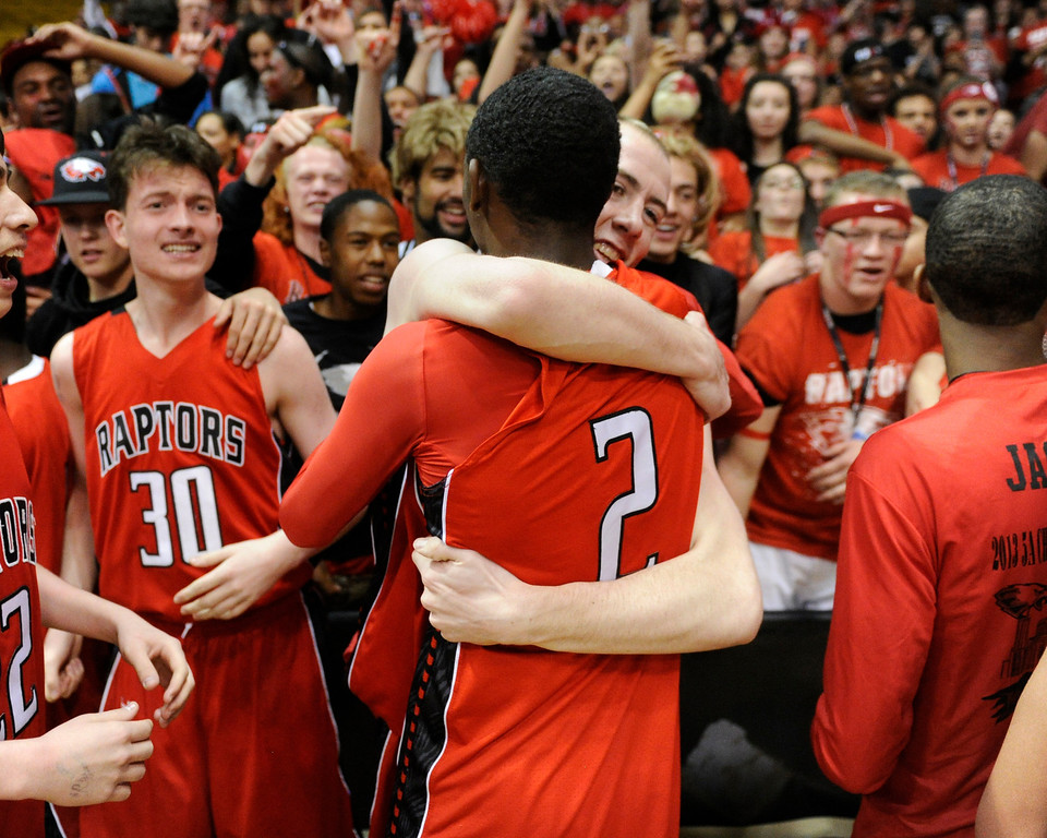 . BOULDER, CO. - MARCH 16: Brnadon Brown embraced TreShawn Wilford in front of the student section. The Eaglecrest High School boy\'s basketball beat Denver East 63-44 in the 5A championship game Saturday, March 16, 2013 at the Coors Events Center in Boulder.  (Photo By Karl Gehring/The Denver Post)