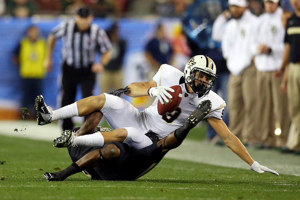. GLENDALE, AZ - JANUARY 01:  Wide receiver J.J. Worton #9 of the UCF Knights is tackled by safety Ahmad Dixon #6 of the Baylor Bears during the Tostitos Fiesta Bowl at University of Phoenix Stadium on January 1, 2014 in Glendale, Arizona.  (Photo by Ronald Martinez/Getty Images)