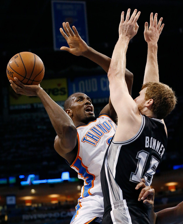 . Oklahoma City Thunder forward Serge Ibaka shoots over San Antonio Spurs forward Matt Bonner (15) in the first half of Game 6 of the Western Conference finals NBA basketball playoff series, in Oklahoma City, Saturday, May 31, 2014. (AP Photo/Sue Ogrocki)